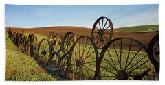 Fence Of Wheels Beach Sheet by Mary Lee Dereske