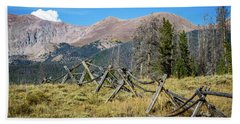 Fences Into The Rockies Beach Towel by Dawn Romine