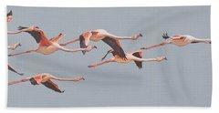 Flamingos In Flight Beach Towel