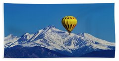 Floating Above The Mountains Beach Towel