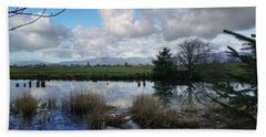 Beach Towel featuring the photograph Flooding River, Field And Clouds by Chriss Pagani