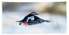 Beach Towel featuring the photograph Flying Woodpecker by Torbjorn Swenelius