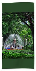 Beach Towel featuring the photograph Fountain Through The Trees By Kaye Menner by Kaye Menner