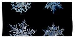 Four Snowflakes On Black Background Beach Sheet
