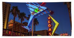 Beach Towel featuring the photograph Freemont East District Neon Signs From The West At Dawn Wide by Aloha Art