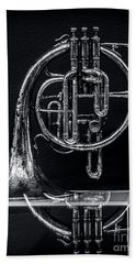 French Horn Beyond A Glass Table Beach Towel