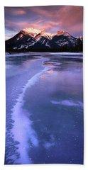 Frozen Sunrise Beach Towel by Dan Jurak