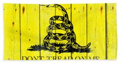 Gadsden Flag On Old Wood Planks Beach Towel by M L C