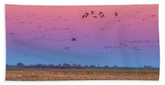 Geese Flying At Sunset Beach Towel by Marc Crumpler