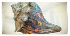 Glowing Conch Shell Beach Towel