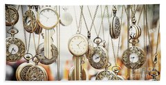 Golden Faces Of Time Beach Towel