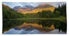 Golden Light At The Torren Lochan Beach Towel