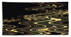 Golden Shimmers On A Dark Sea Beach Towel