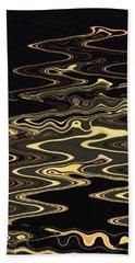 Golden Shimmers On A Dark Sea Beach Towel
