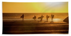 Beach Towel featuring the photograph Golden Surfers by Mitch Shindelbower