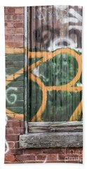 Beach Towel featuring the photograph Graffiti Covered Wall Of An Old Abandoned Factory by Edward Fielding