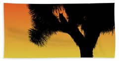 Great Horned Owl In A Joshua Tree Silhouette At Sunset Beach Towel