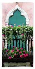 Beach Towel featuring the photograph Green Ornate Door With Geraniums by Donna Corless