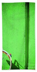 Beach Towel featuring the photograph Green Wall And Bicycle Wheel by Silvia Ganora
