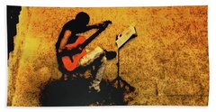 Guitar Player In Arles, France Beach Towel
