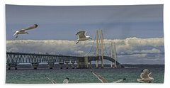 Gulls Flying By The Bridge At The Straits Of Mackinac Beach Towel