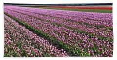 Half Side Purple Tulip Field Beach Towel by Mihaela Pater