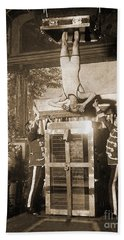 Harry Houdini Suspended Above A Tank Of Water  Beach Towel