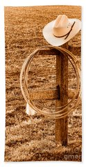 Hat And Lariat On A Post - Sepia Beach Towel