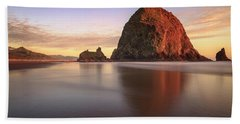 Beach Towel featuring the photograph Haystack Rock Sunset by Adam Romanowicz