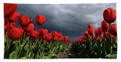 Heavy Clouds Over Red Tulips Beach Sheet by Mihaela Pater