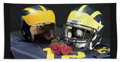 Helmets Of Different Eras With Jersey And Roses Beach Towel