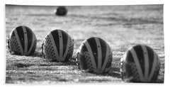 Helmets On Dew-covered Field At Dawn Black And White Beach Towel