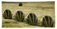 Helmets On Dew-covered Field At Dawn Beach Towel