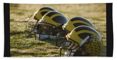 Helmets On The Field At Dawn Beach Towel