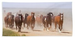 Herd Of Horses During The Great American Horse Drive On A Dusty Road Beach Towel