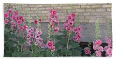 Beach Towel featuring the photograph Hollyhocks by Cynthia Powell