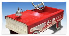 Beach Towel featuring the photograph Hook And Ladder Peddle Car by Mike McGlothlen