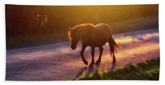 Horse Crossing The Road At Sunset Beach Towel by Mikel Martinez de Osaba