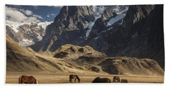 Horses Grazing Under Siula Grande Beach Towel