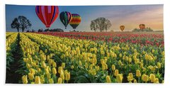 Hot Air Balloons Over Tulip Fields Beach Sheet