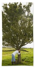 Beach Towel featuring the photograph Hugging The Fairy Tree In Ireland by Ian Middleton