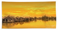 Beach Towel featuring the photograph Huts Yellow by Charuhas Images