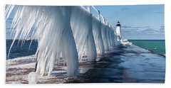 Ice On Manistee Pierhead Light Beach Towel