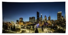 ice ribbon and Chicago Skyline Beach Towel
