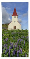 Beach Sheet featuring the photograph Icelandic Church Among The Fields Of Lupine by Edward Fielding