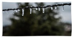 Icicles On Wire Beach Towel by Karen Slagle