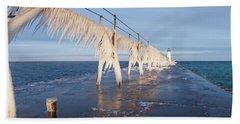 Icy Manistee Pierhead Lighthouse Beach Towel