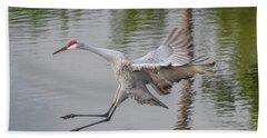 Ike The Crane's Grouchy Day Beach Towel