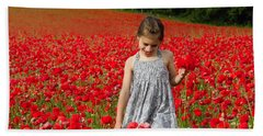 In A Sea Of Poppies Beach Towel by Keith Armstrong