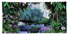 In The Garden At Mount Zion Hotel  Beach Towel by Lydia Holly